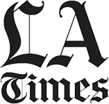 Logo Recognizing Law Office of John D. Barnett's affiliation with LA Times